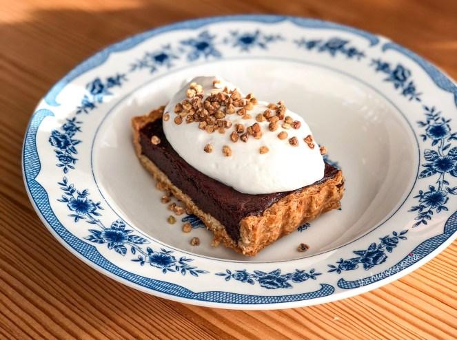 Chocolate Tart, grapefruit cream & candied buckwheat.