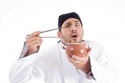 Chef holding chopsticks