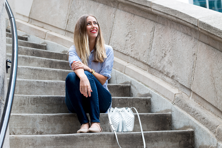 Sitting on steps in blue shirt