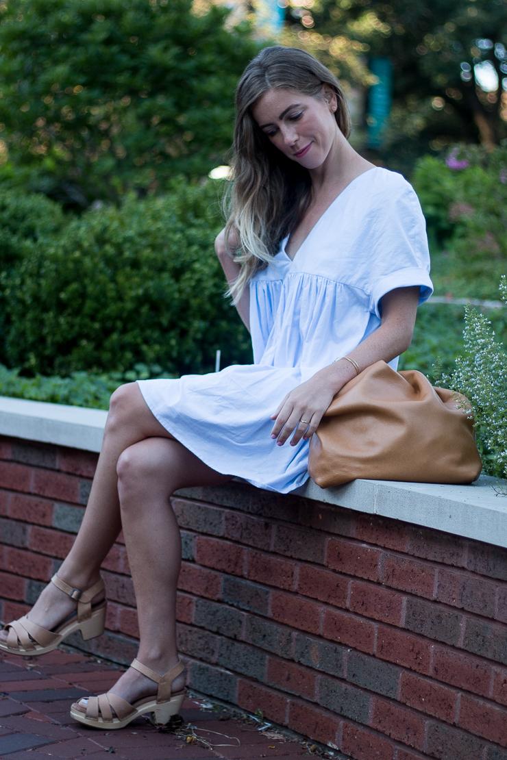 sitting in blue dress