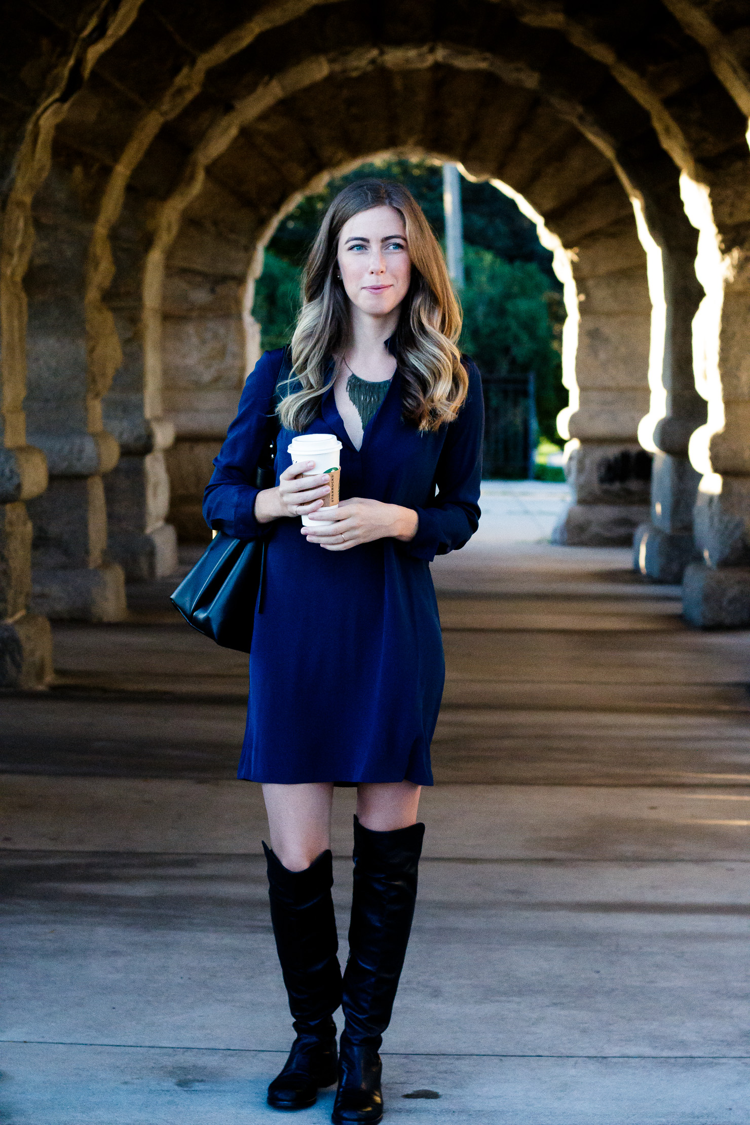 black over the knee boots, blue dress