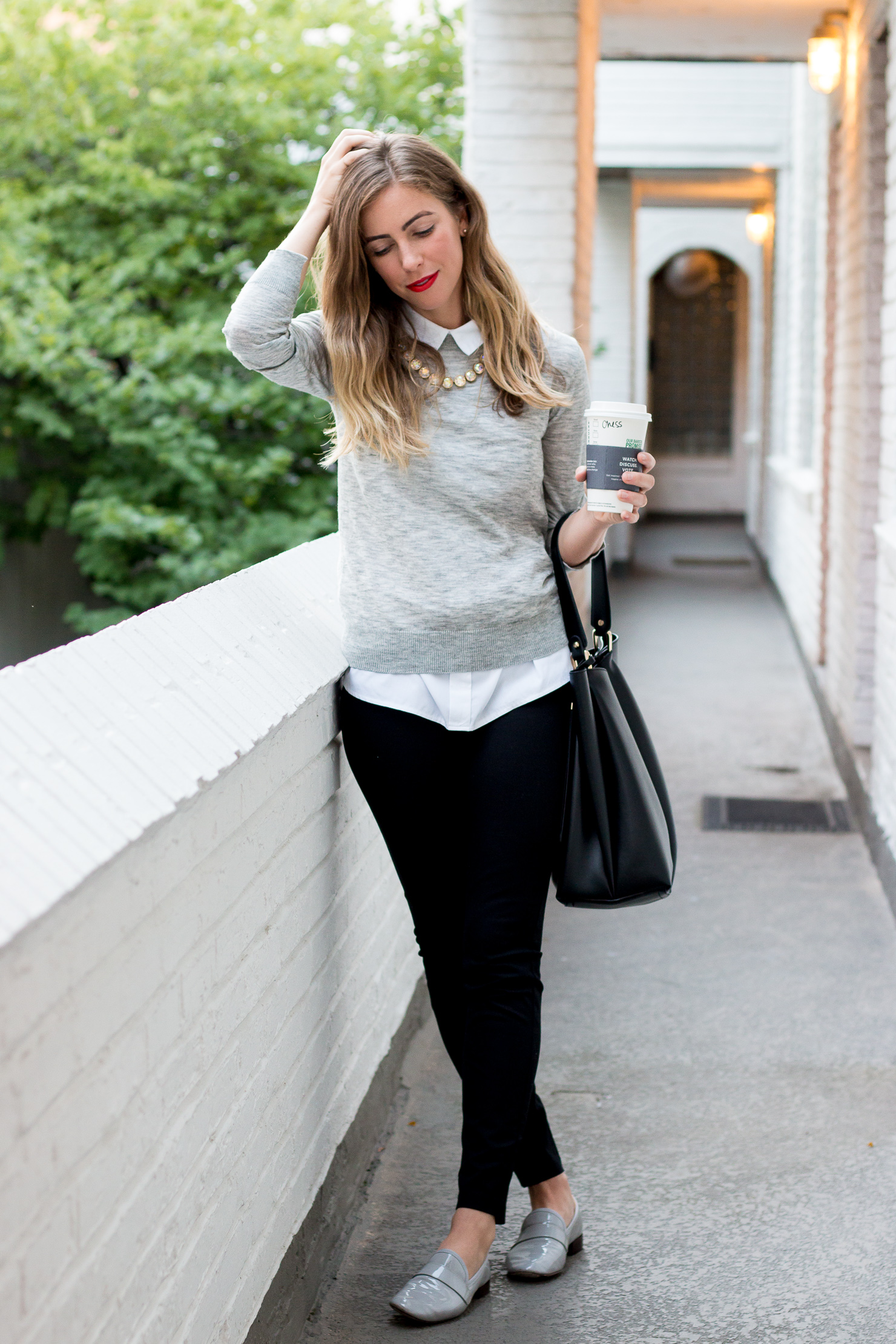 black pants, gray loafers