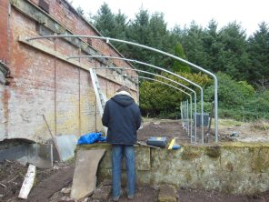 Nat working hard on the polytunnel.
