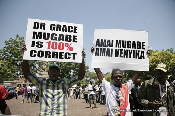 Zanu PF youths hold placards in support of Grace Mugabe.