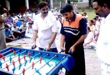Director Public Instructions (Schools), Chandigarh) trying his hands at the table soccer refresher course held in Chandigarh on Saturday.