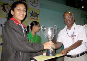 Regional Executive Director and President, Sports Control Board, Northern Region, Airport Authority of India, Mr. A. Murugesan presenting the women's singles trophy to Divya Deshpande in Chandigarh on Saturday. photo by Balbir Singh