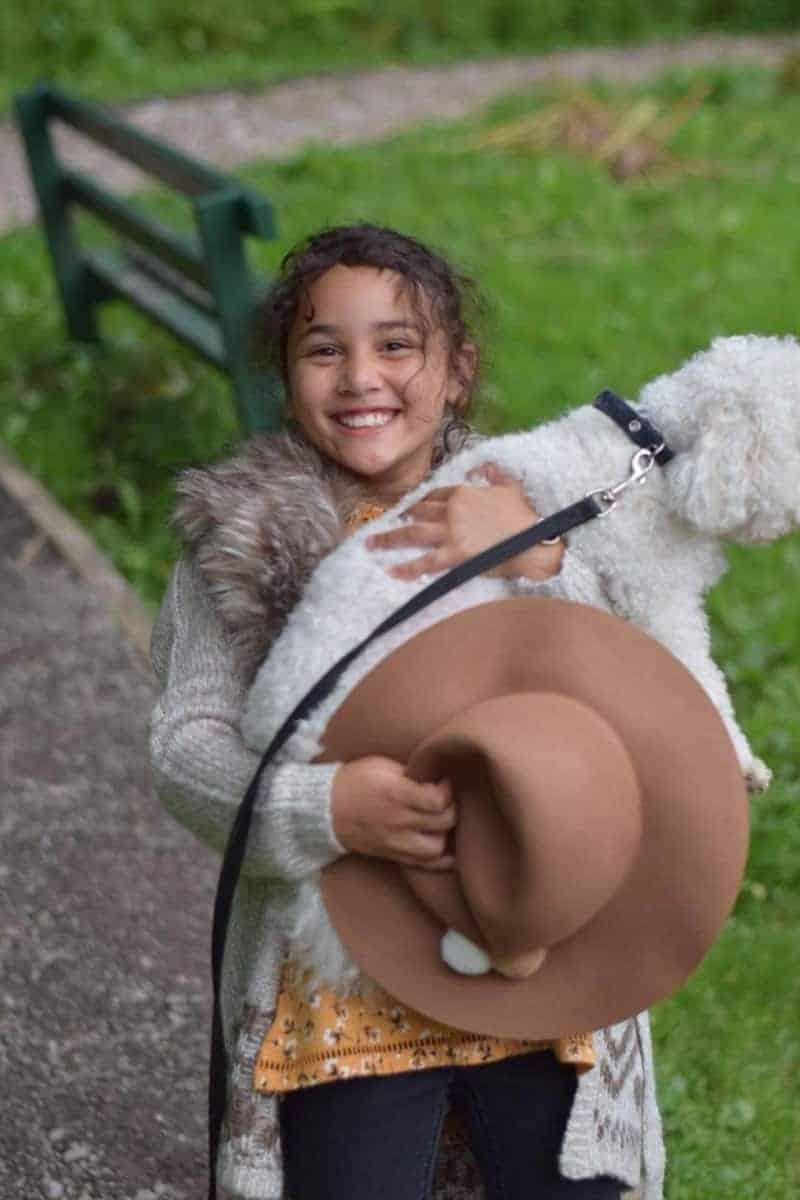sylvia holding bichon dog