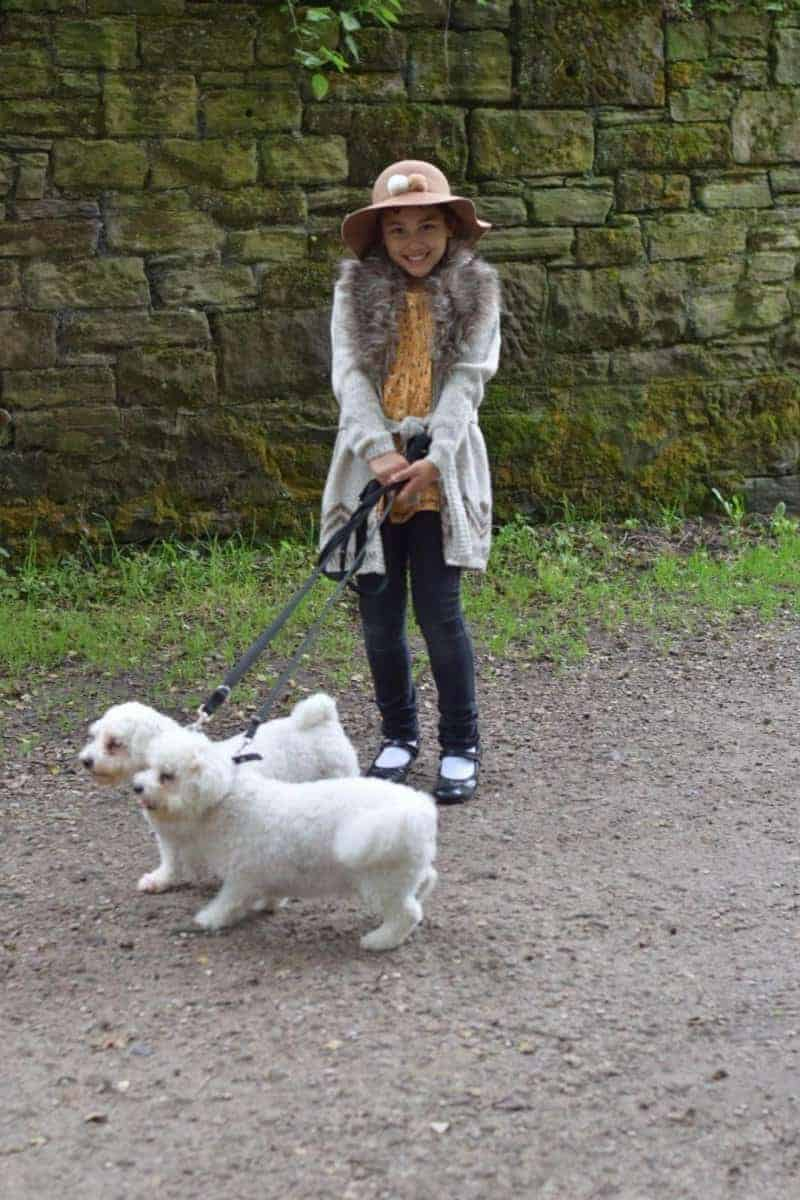 girl and bichon dog