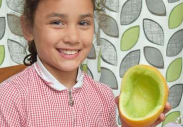smiling child with melon