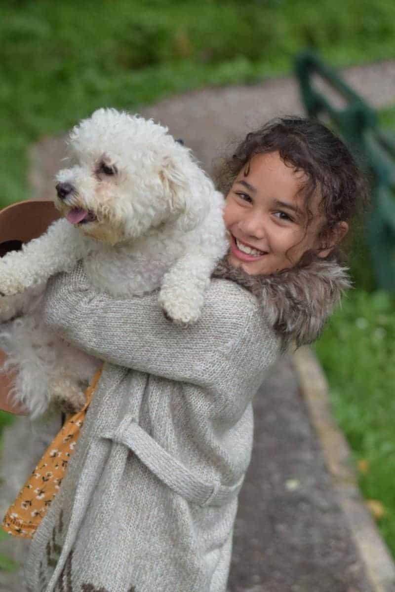 sylvia cuddling Yoda the dog in Autumn clothes
