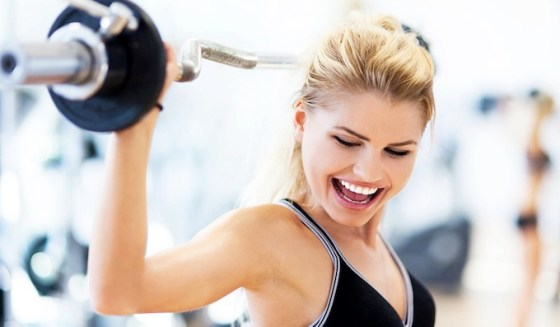 woman at the gym with weights