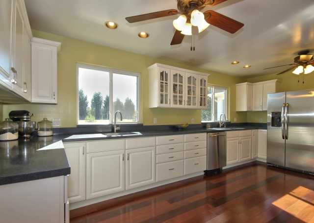 renovated kitchen two sinks and stainless steel appliances