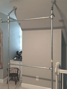 DIY Pipe Closet Design House Flippers Home angled ceiling