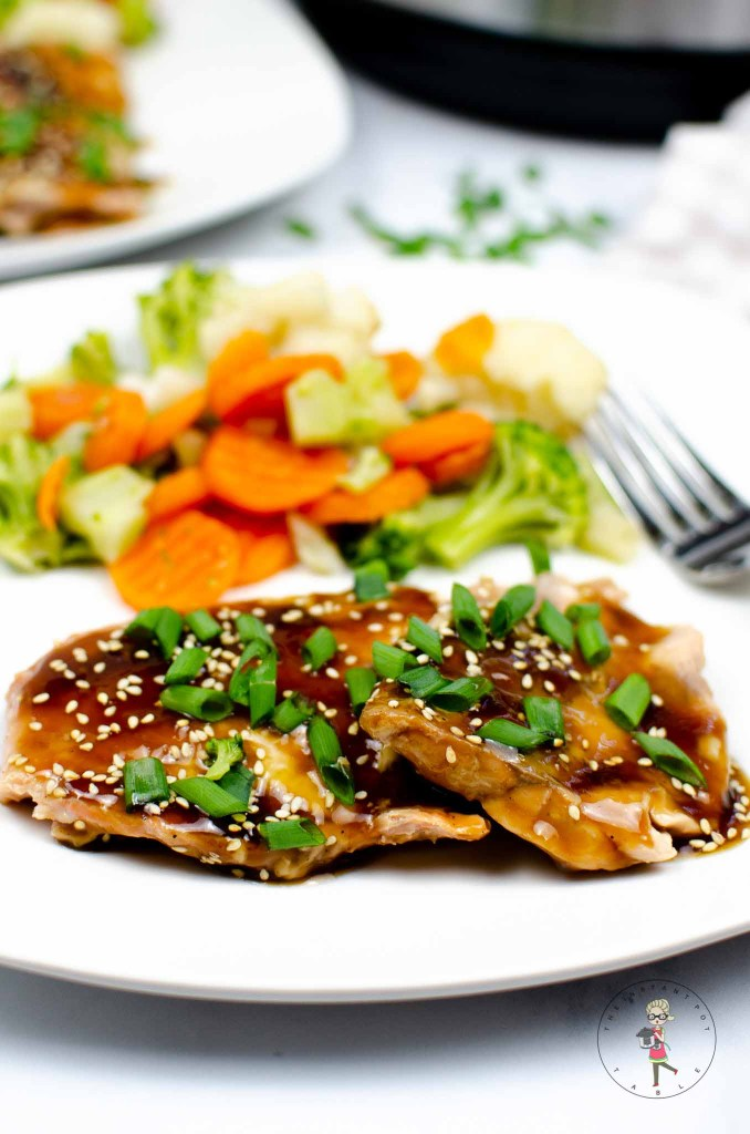 instant pot teriyaki salmon on a plate with vegetables