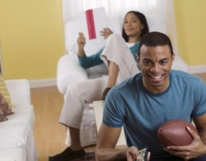 guy-watching-football-woman-bored