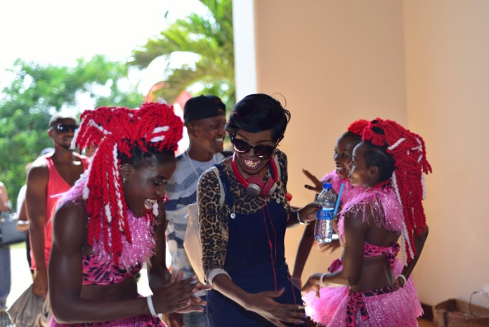 Adelle Onyango joins the Sarakasi dancers at Vipingo Ridge during Coca-Cola's Taste The Feeling Launch