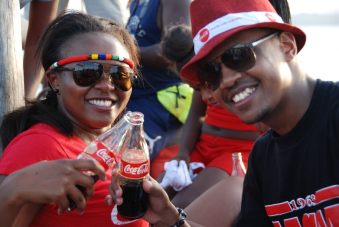 Amy Wahome and he hype master DNG take a breeze at the ocean with a refreshing Coca-Cola