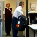 Transportation Security Administration (TSA) screeners check passengers
