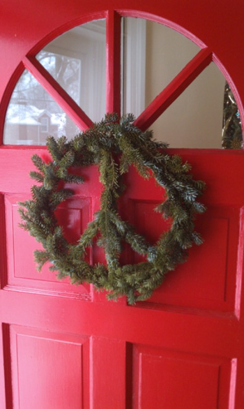 peace wreath on a red door