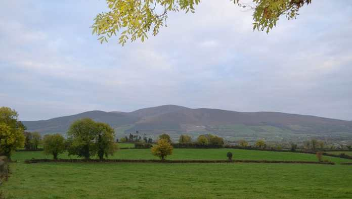 Sweeping view of the Anner Valley with the famous Slievenamon Mountain in the background - The Irish Place