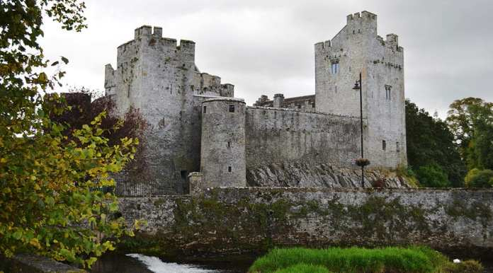 A view of the magnificent Cahir Castle from the banks of the River Suir - The Irish Place
