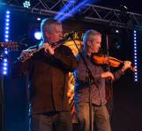 Liam Kelly and Tom Morrow of Dervish on stage at the Doolin Folk Festival 2016. - The Irish Place