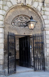 The Front Door of Kilmainham Gaol with the Hydra Motif visible above the door. - The Irish Place