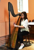 Mairead Murphy of the Irish Traditional Folk Group Dúnaill playing the Celtic Harp. - The Irish Place