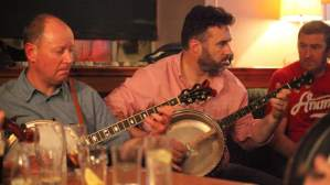 Banjos being played in a session at the Ennis Trad Fest 2015 - The Irish Place