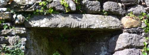 The Ogham Stone used as a lintel in the lower window in the Western Gable wall in Seskinan Church - The Irish Place