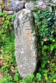 The freestanding Ogham Stone in the Northwest corner in Seskinan Church - The Irish Place