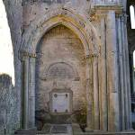 The bricked up entrance of the North Transcept Chapel at Corcomroe Abbey - The Irish Place