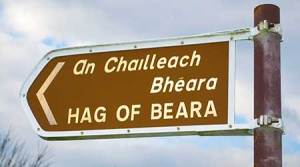 Tourist information signpost by the roadside showing the location of the Hag of Beara