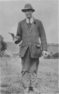 Commandant Séamus Hennessy, who presided over Private Chalmers execution and secret burial in June 1921, posing with Webley revolver during the Civil War.