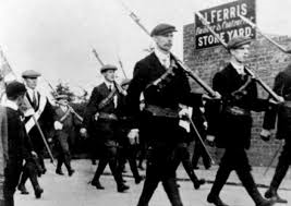 The UVF parade armed at Larne, an event that took place the same day as the suffragette's Daffodil day.