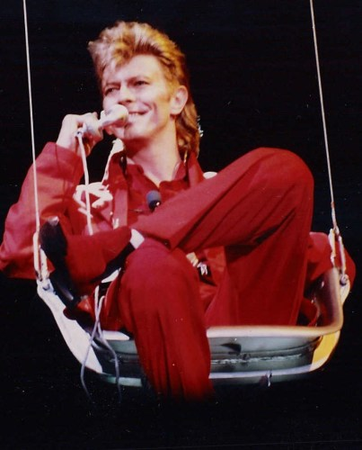 "David Bowie being lowered from the spider set's ceiling, to the opening song ""Glass Spider"" at Rock am Ring – 7 June 1987 Fashion mourns the loss of Bowie"