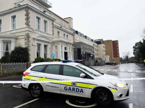 05/02/2016 Regency Hotel shooting scene. Gardai outside the Regency Hotel, Swords Road, Dublin 9 where a shooting incident occurred at 2.30 pm today. Gardai report that three men, all in their 20s or 30s, were found injured at the scene, and one of the men was subsequently pronounced dead. The two others were removed to The Mater and Beaumont hospitals with possible gunshot wounds. Photograph: Sasko Lazarov / RollingNews.ie