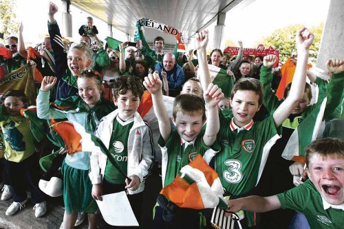 Boys in green welcomed home
