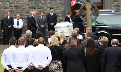 Nation mourns murdered family