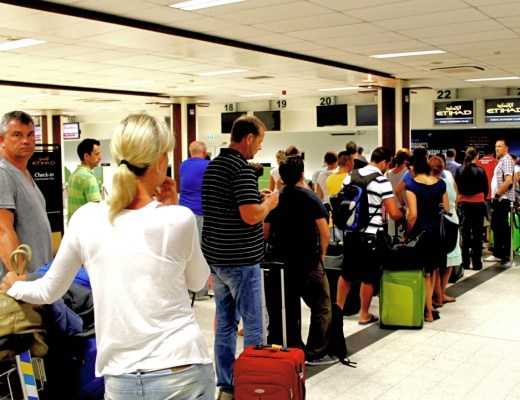 Passengers queue for check-in at Ibrahim Nasir International Airport