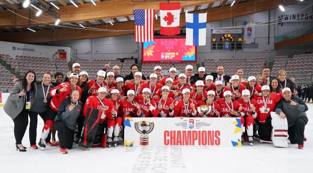 Team Canada poses after winning Worlds. (photo courtesy of @HockeyCanada on Twitter)