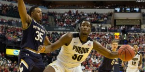 Dec 17, 2016; Indianapolis, IN, USA;  Purdue Boilermakers forward Caleb Swanigan (50) dribbles the ball while Notre Dame Fighting Irish forward Bonzie Colson (35) defends in the second half of the game at Bankers Life Fieldhouse. The Purdue Boilermakers beat Notre Dame Fighting Irish 86-81. Mandatory Credit: Trevor Ruszkowski-USA TODAY Sports