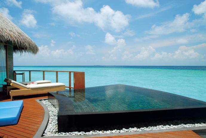 Stay in overwater villa