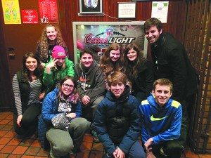 Temple Beth El youth are out with their Teen Network Weaver Joseph Unger, right.
