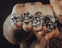 https://www.pexels.com/photo/man-wearing-silver-skull-ring-194087/
