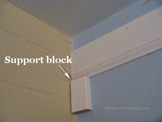 install crown molding on a brick wall