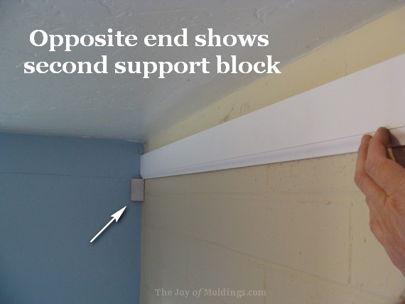 crown molding buildup on brick wall