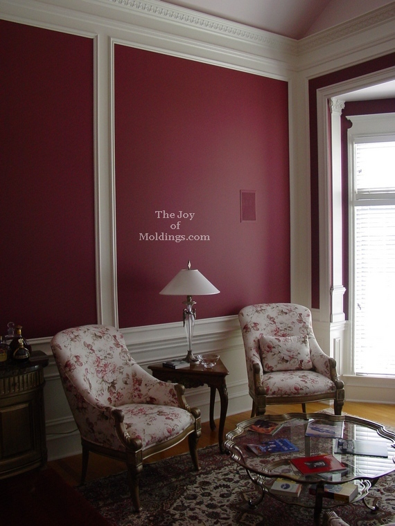 room with red walls and white moldings