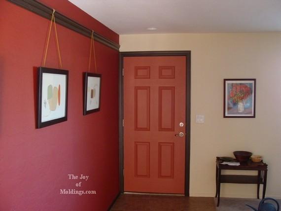 red front door with black dark trim molding