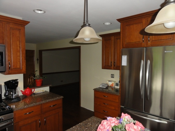 dark stained kitchen cabinet crown molding